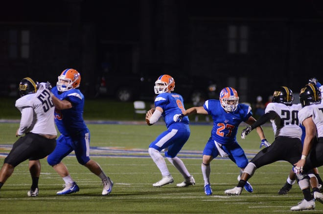 Louisiana College quarterback Mason Jordan (9) scans the field for a pass against Texas Lutheran last week.