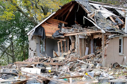 A few neighboring properties were also damaged in an explosion that leveled a home Wednesday morning in Harrison.