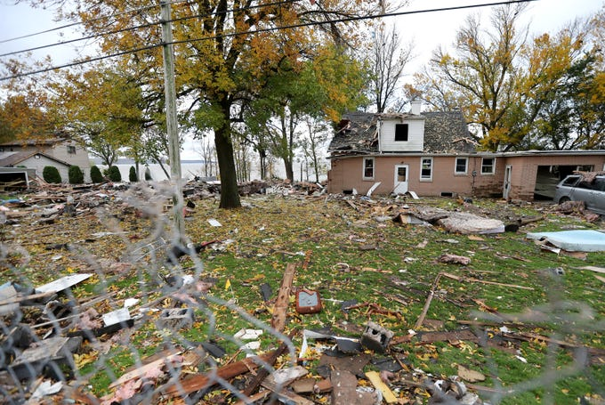 The scene of a house explosion that completely destroyed one home and left neighboring properties damaged Thursday, Oct. 11, 2018, in Harrison, Wis.