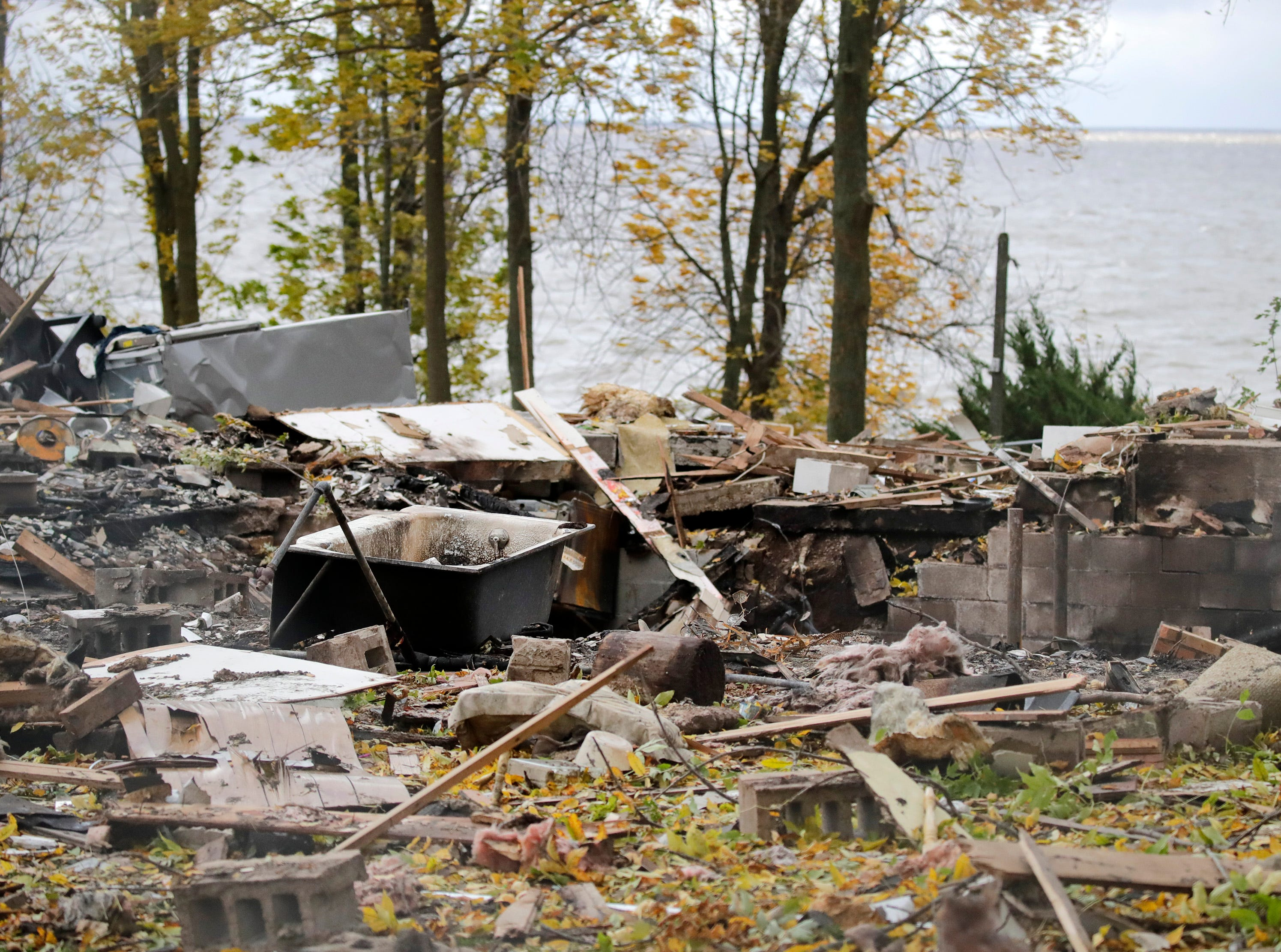 Debris lay scattered from what is left of the property at W5639 Firelane 12 after an explosion destroyed the home Thursday, Oct. 11, 2018, in Harrison, Wis.