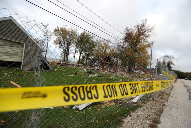 The debris from a house explosion Wednesday morning in Harrison was still scattered around the scene a day later.