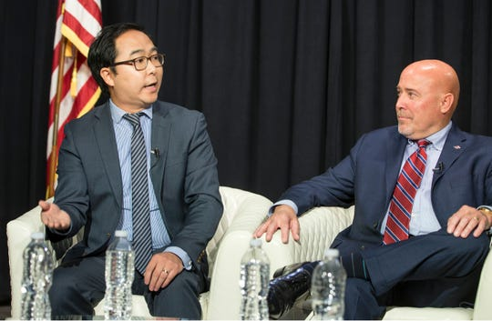 Andy Kim and Tom MacArthur during an editorial board meeting with members of the Asbury Park Press and Gannett New Jersey on Oct. 11, 2018.