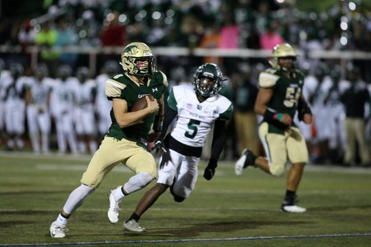 Red Bank Catholic quarterback Steve Lubischer shown running for a touchdown last week in the Caseys' 41-14 win over Long Branch is the Asbury Park Press Player of the Week in voting by the fans on app.com