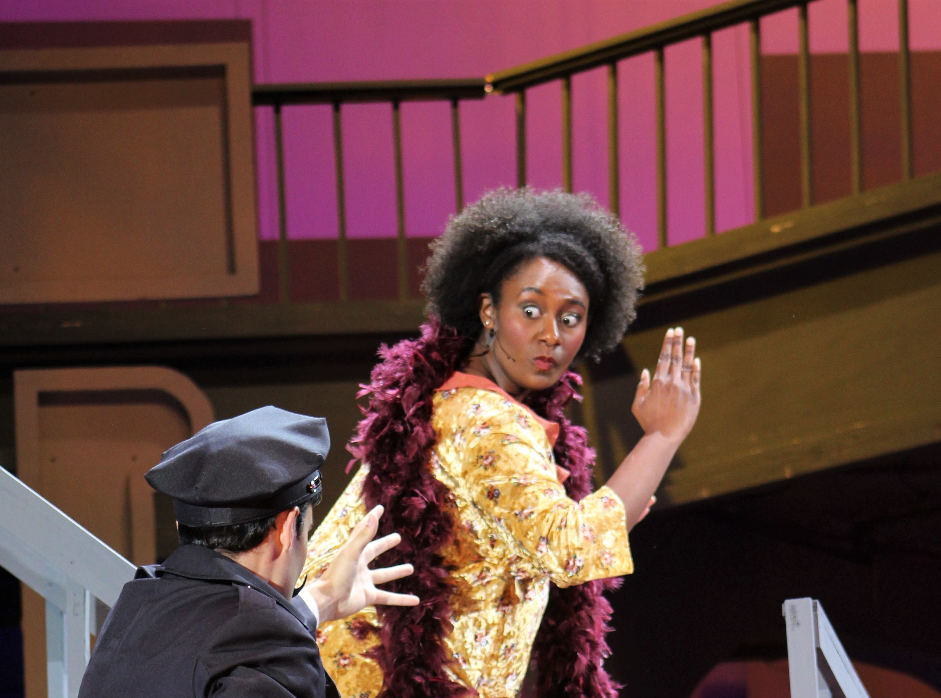 """Policeman Lonigan (Rankin Dean) gets after a Greenwich Village resident named Violet (Cleo Lissade) in this rehearsal scene from """"Wonderful Town,"""" Abilene Christian's 2018 homecoming musical."""