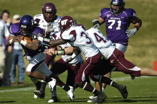 Abilene Christian University's Bernard Scott (3) gets the attention of several West Texas A&M defenders during their NCAA Division II playoff game at Shotwell Stadium in 2008.
