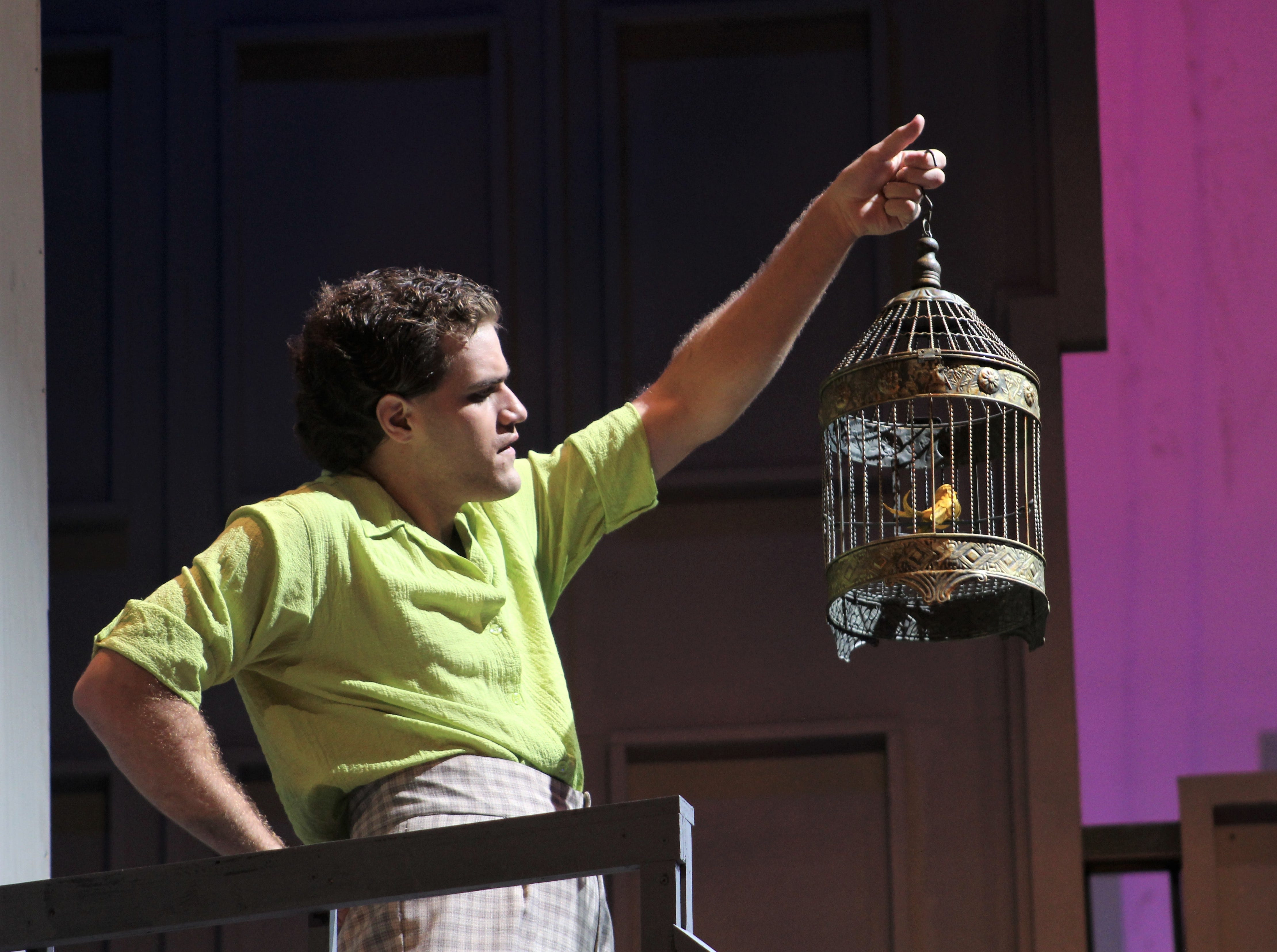"""Wreck (Lance Bleakney) muses about the value of bird in a cage in this rehearsal scene of """"Wonderful Town,"""" Abilene Christian's homecoming musical."""
