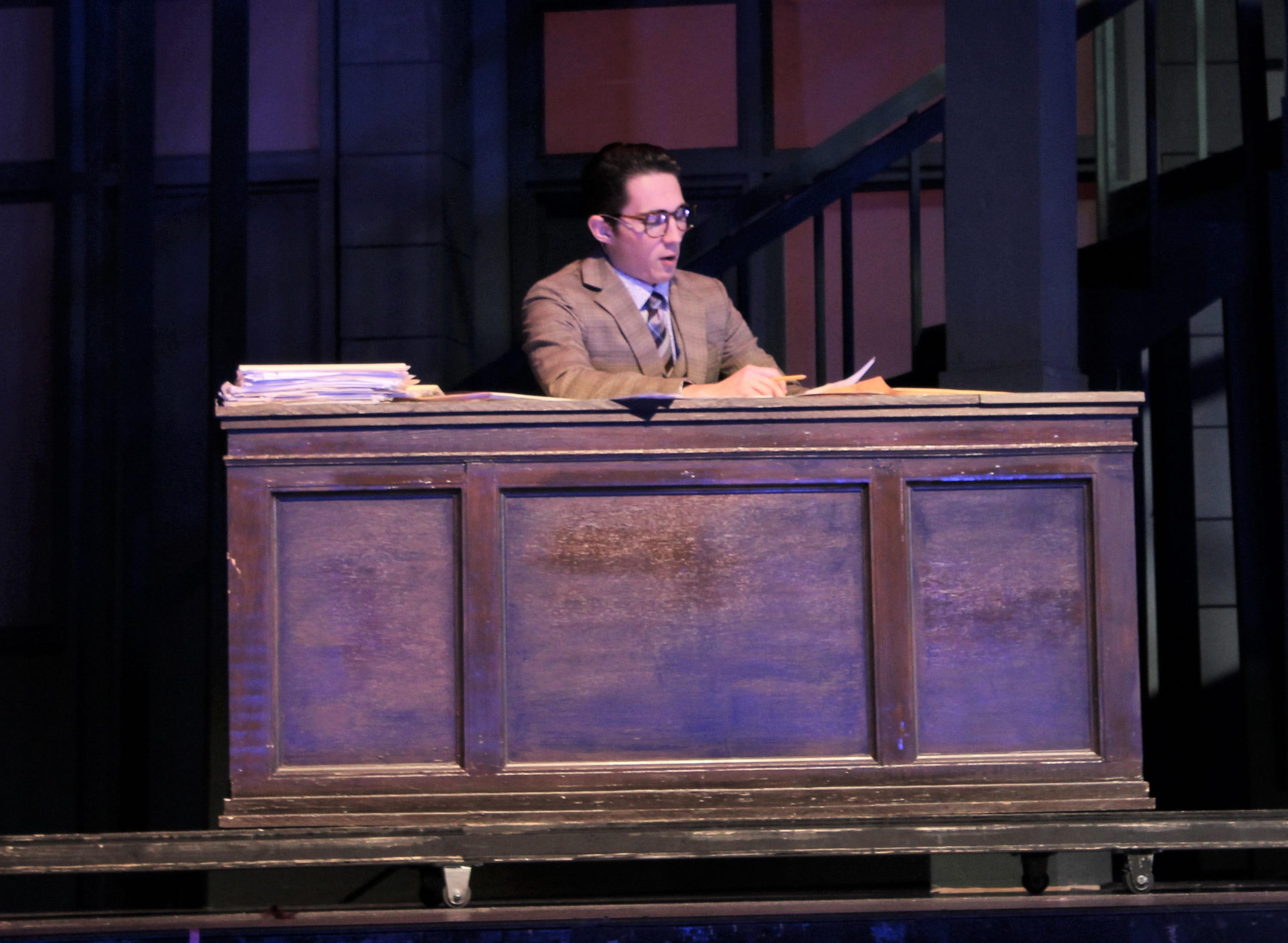 """Robert Baker (Andrew Boone) has dismissed aspiring writer Ruth Sherwood, then reads her stuff when alone in this rehearsal scene from """"Wonderful Town,"""" Abilene Christian's homecoming musical for 2018."""