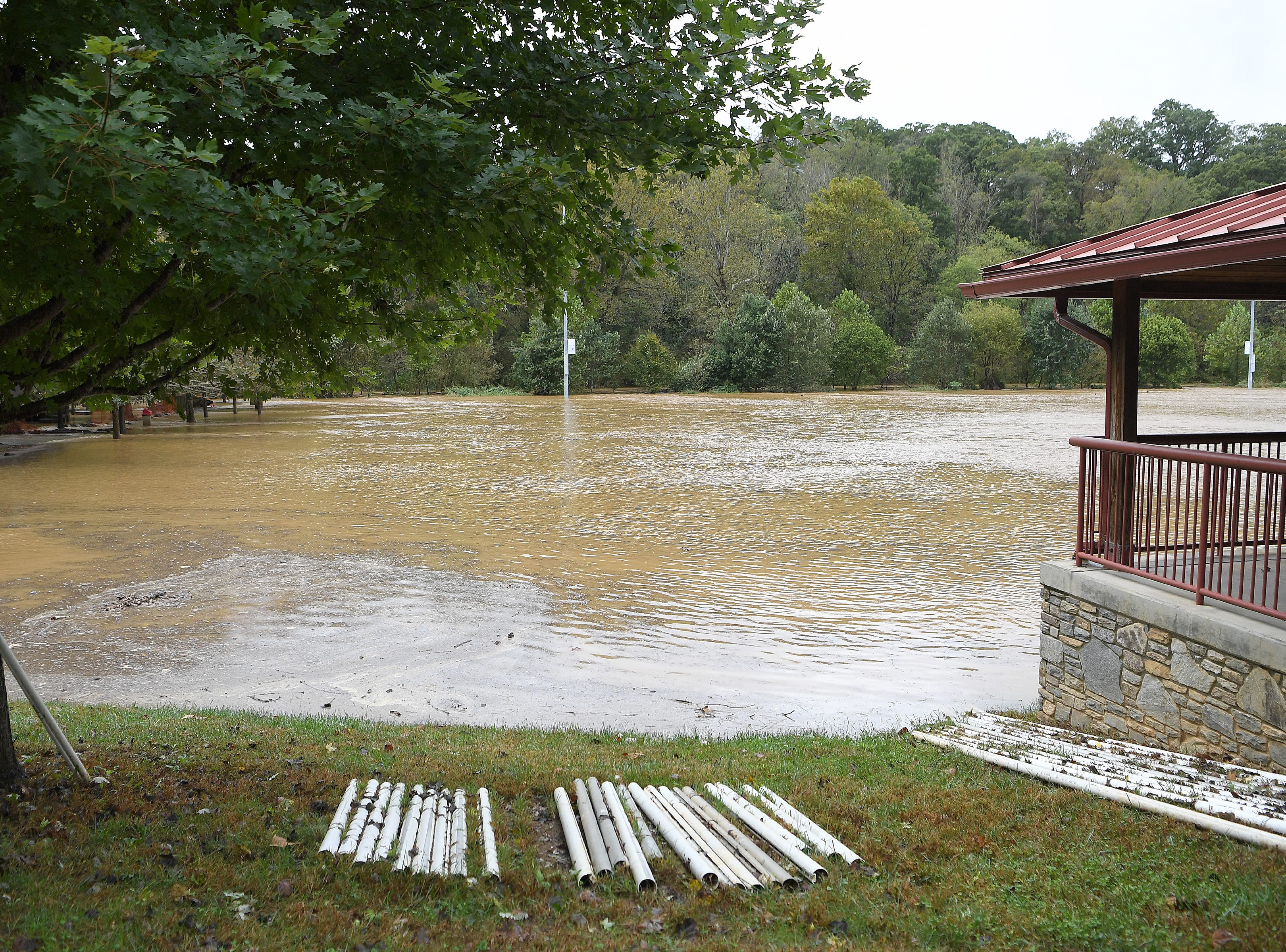The John B. Lewis Soccer Complex is covered in water as the Swannanoa River floods because of rains from Hurricane Michael on Oct. 11, 2018.