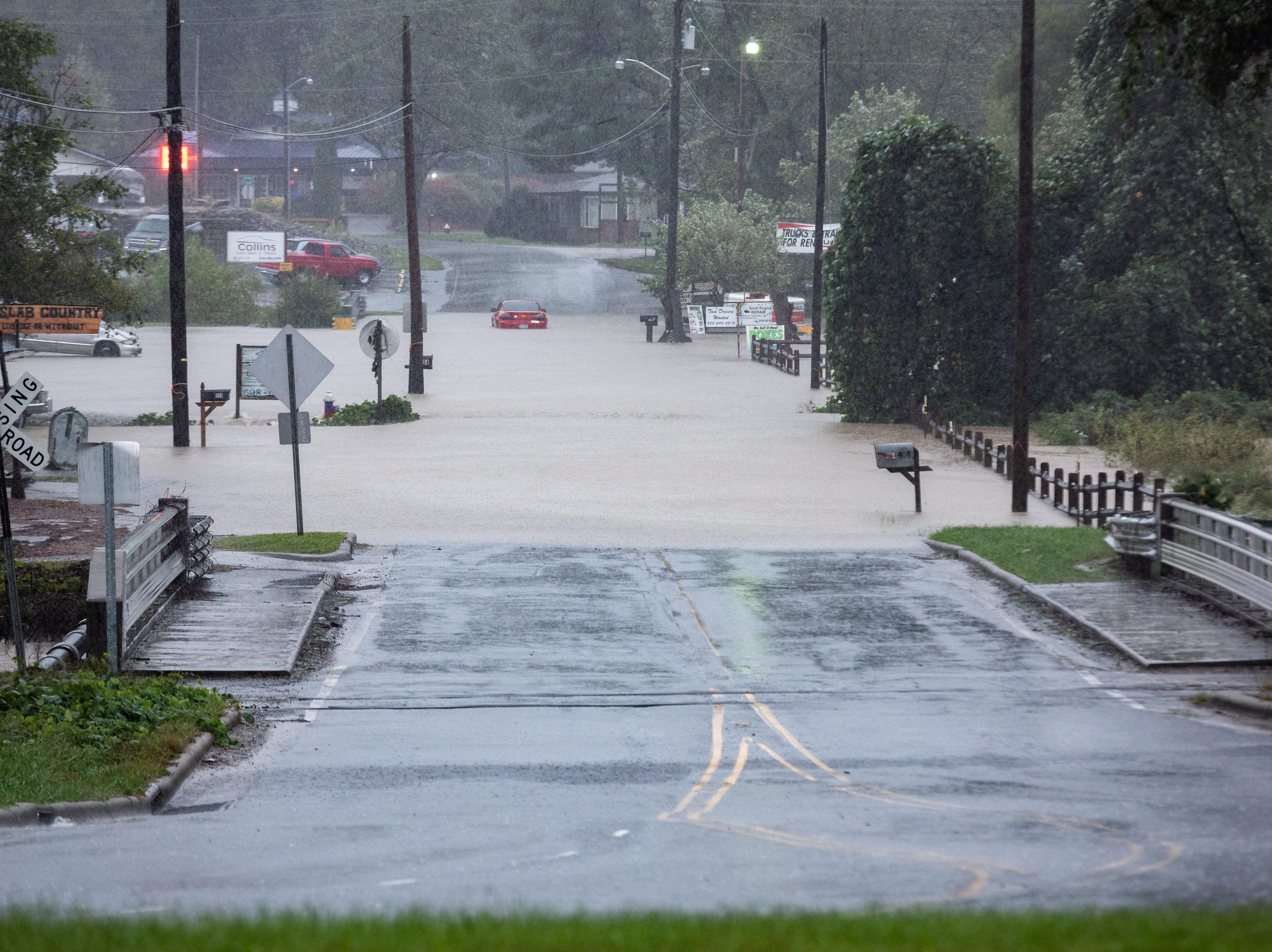 Floodwaters from Mud Creek floods a section of Grove Street in Hendersonville Oct. 11, 2018.