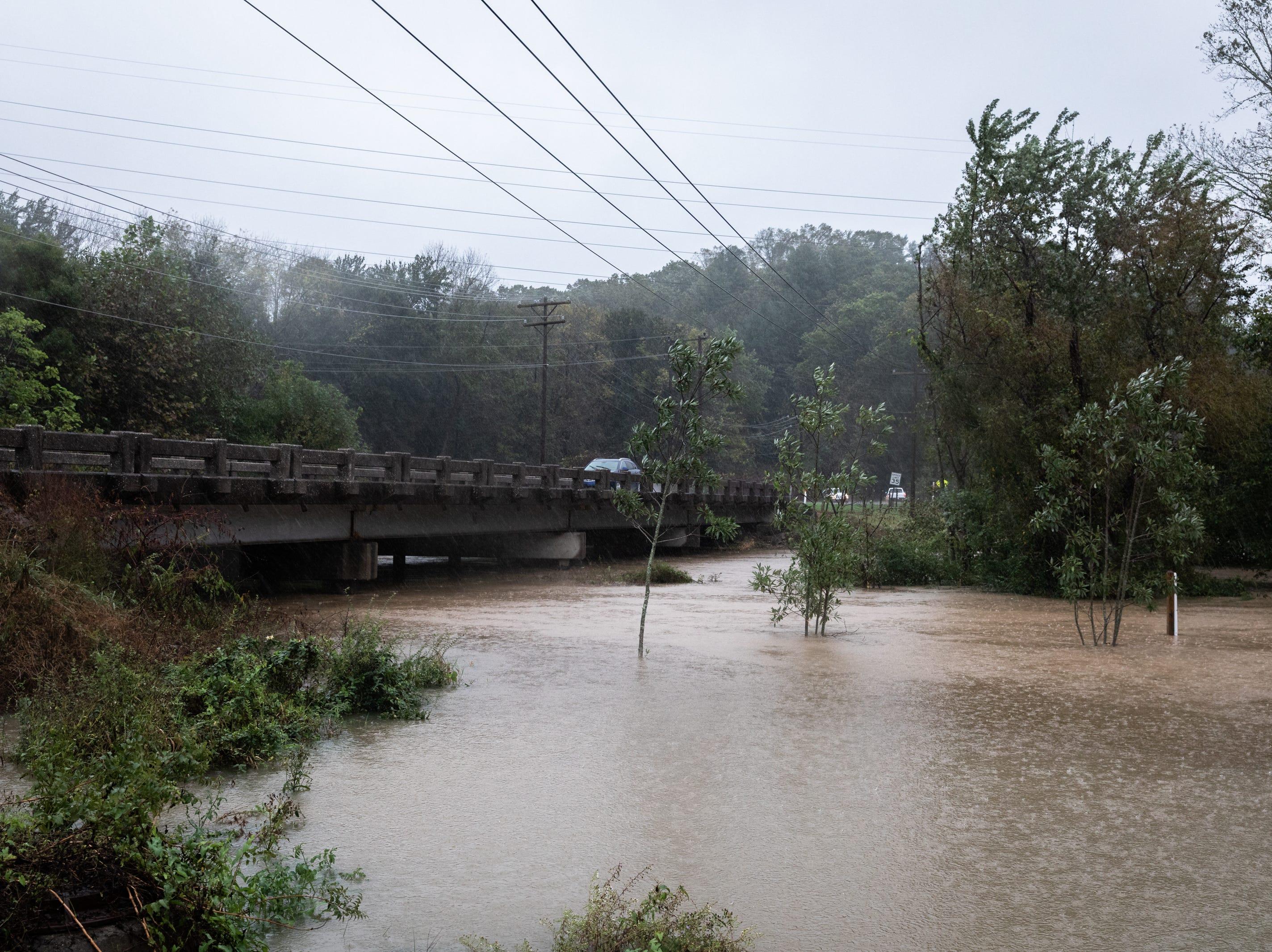 Mud Creek floods the Oklawaha Greenway on Berkeley Road in Hendersonville Oct. 11, 2018.