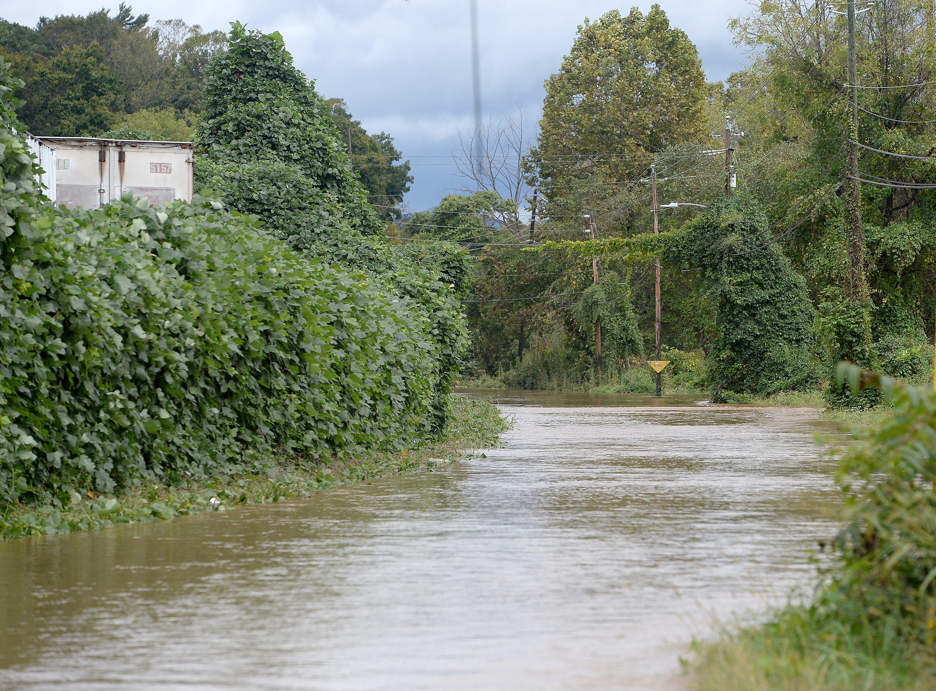 A section of Swannanoa River Road was closed due to flooding of the Swannanoa River as a result of rains from Hurricane Michael on Oct. 11, 2018.