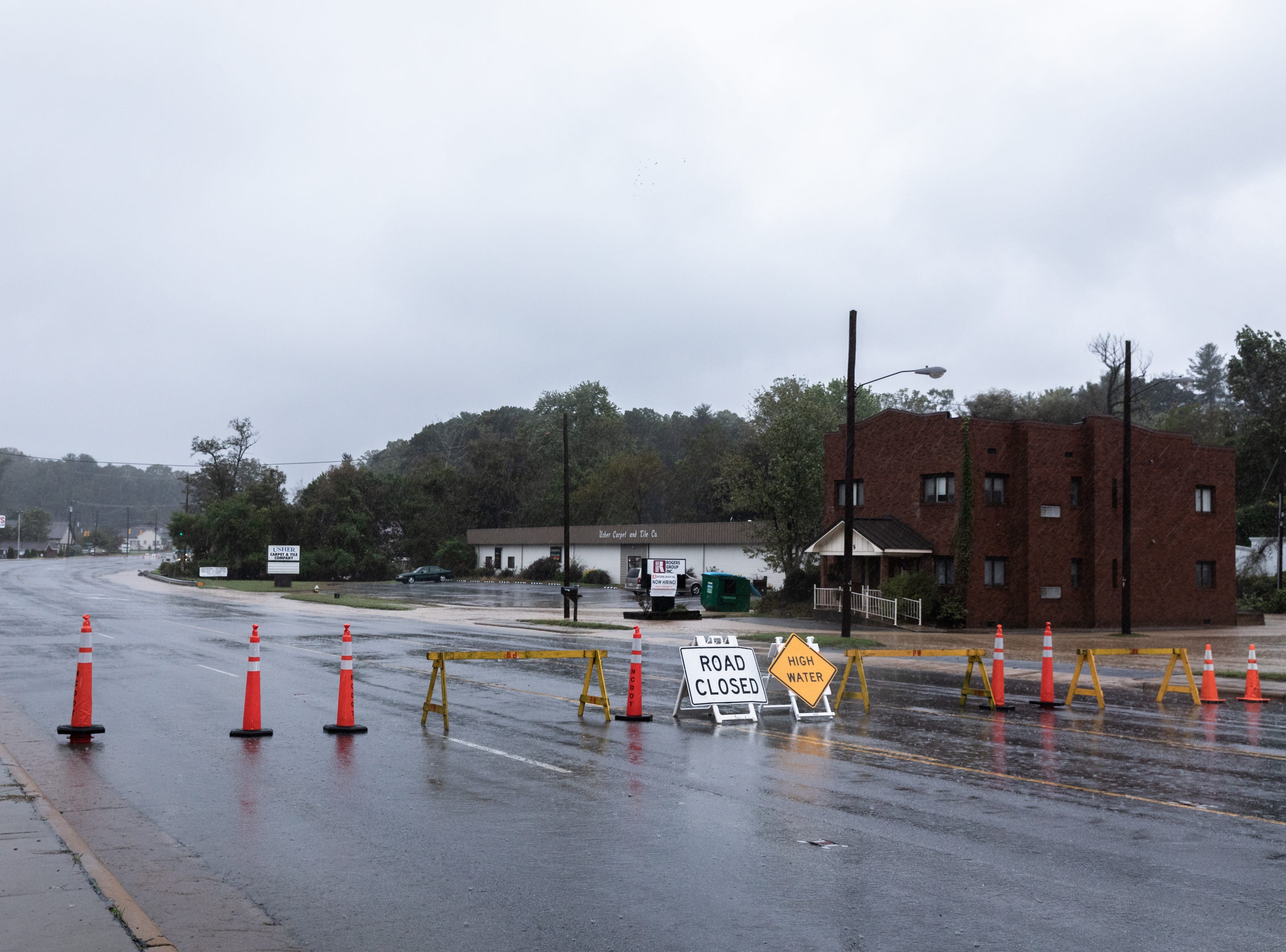 A roadblock on Asheville Highway in Hendersonville where several roads have been closed due to flooding Oct. 11, 2018.