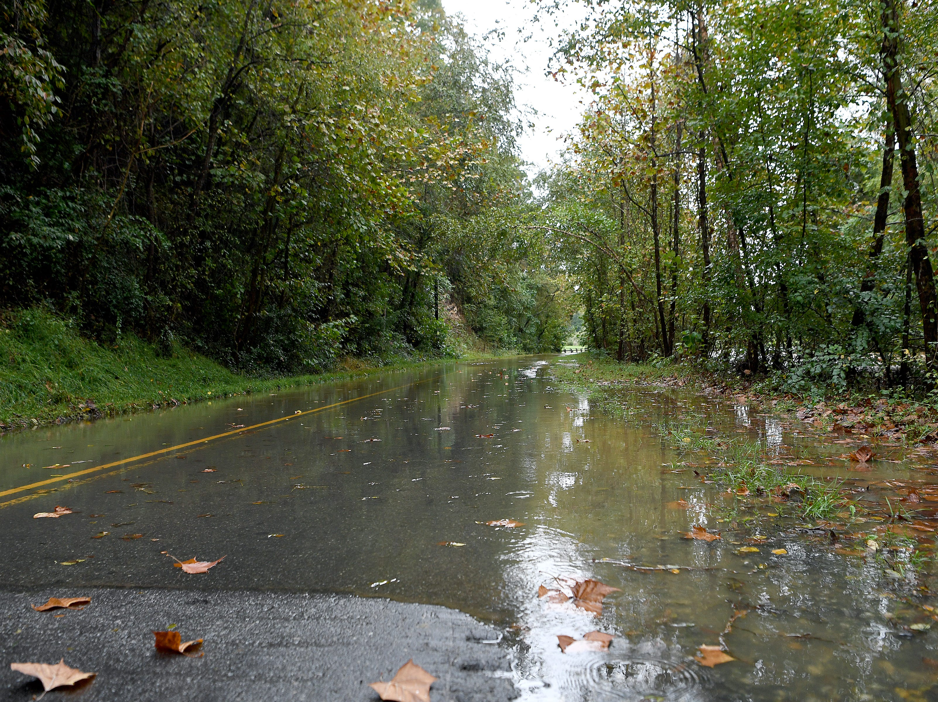 A portion of Azalea Road is closed as the Swannanoa River floods on Oct. 11, 2018.