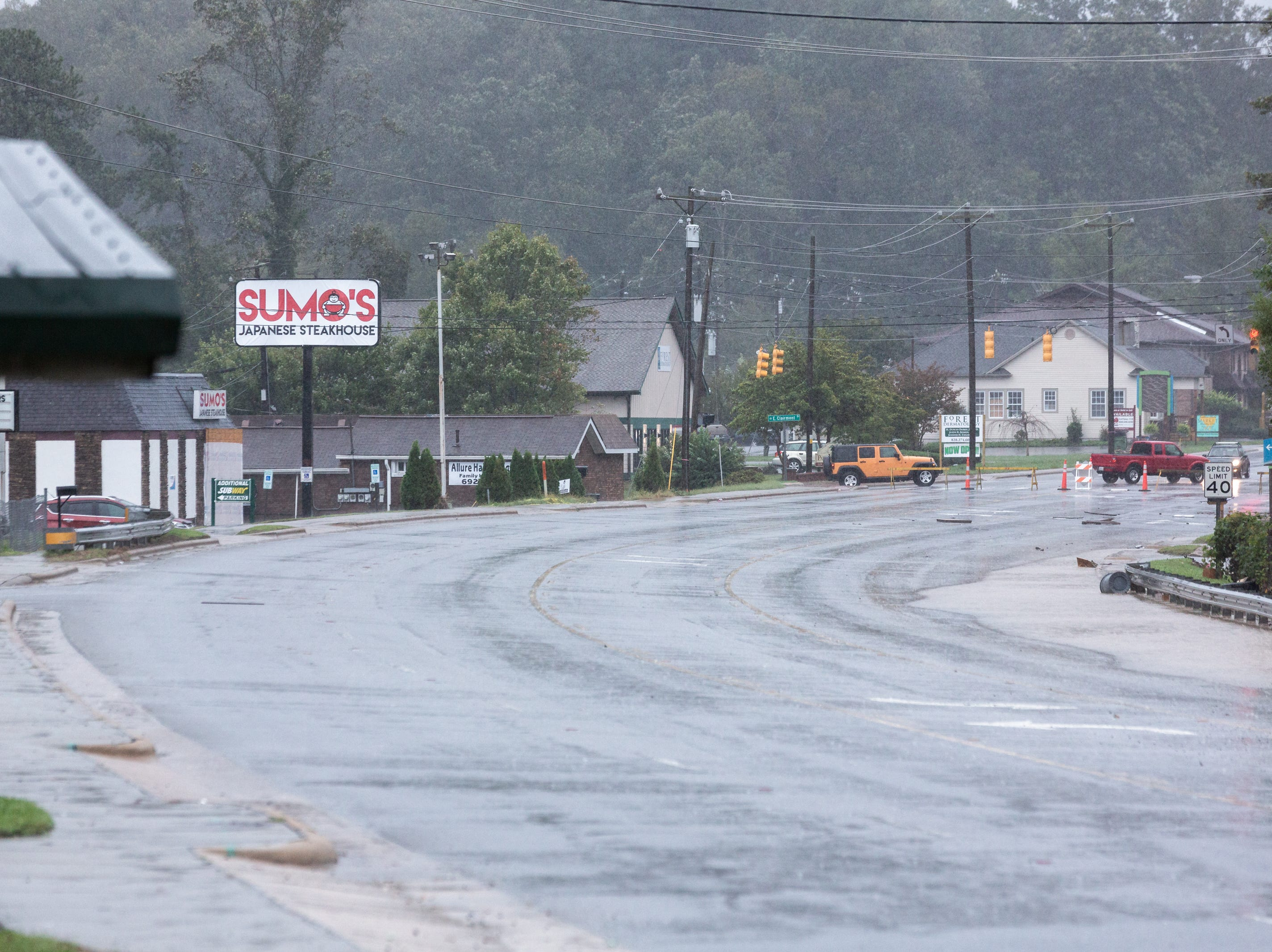 A section of Asheville Highway sits closed to traffic in Hendersonville due to flooded areas Oct. 11, 2018.