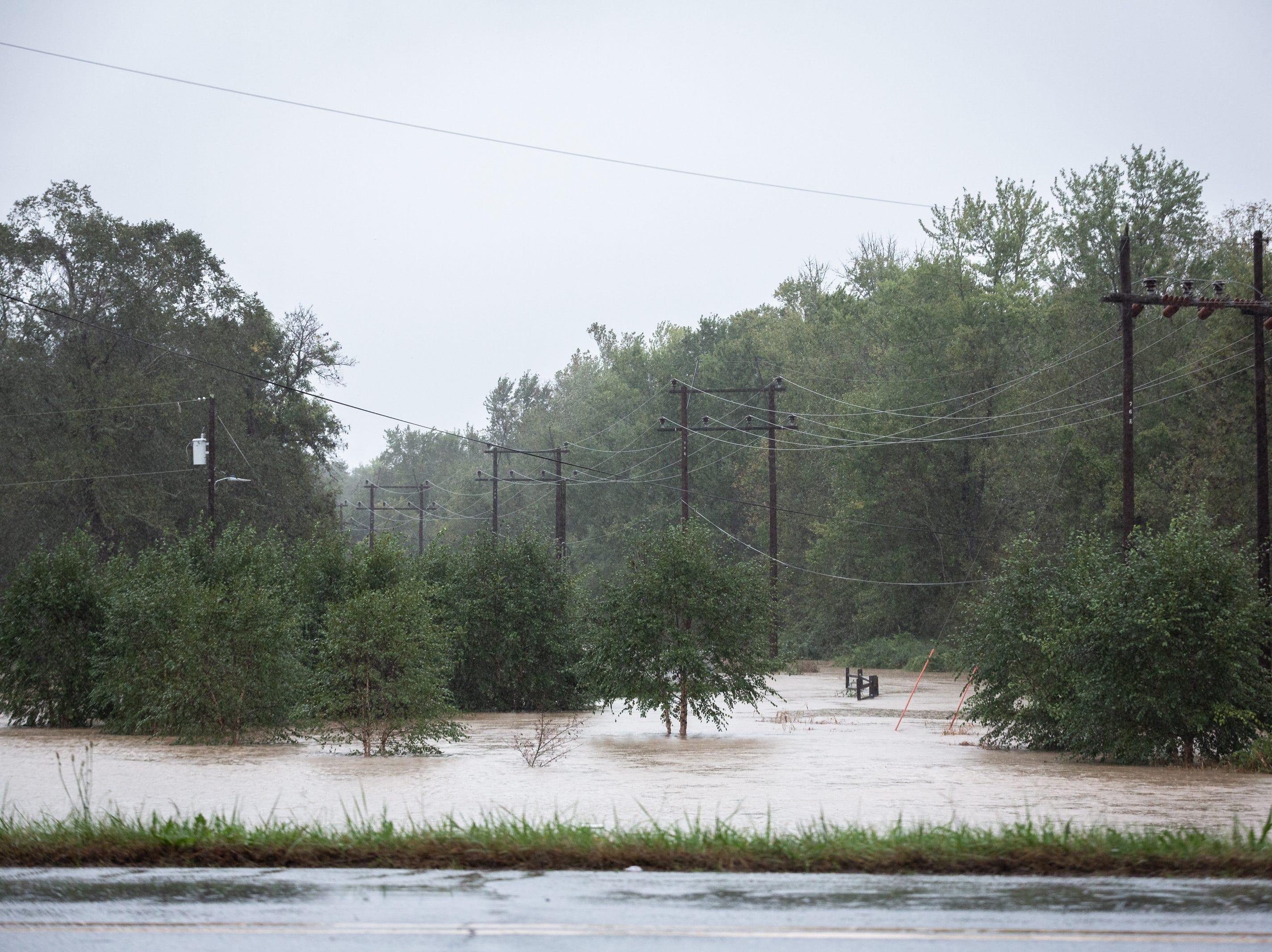 Mud Creek floods low-lying areas on Berkeley Road in Hendersonville, Oct. 11, 2018.