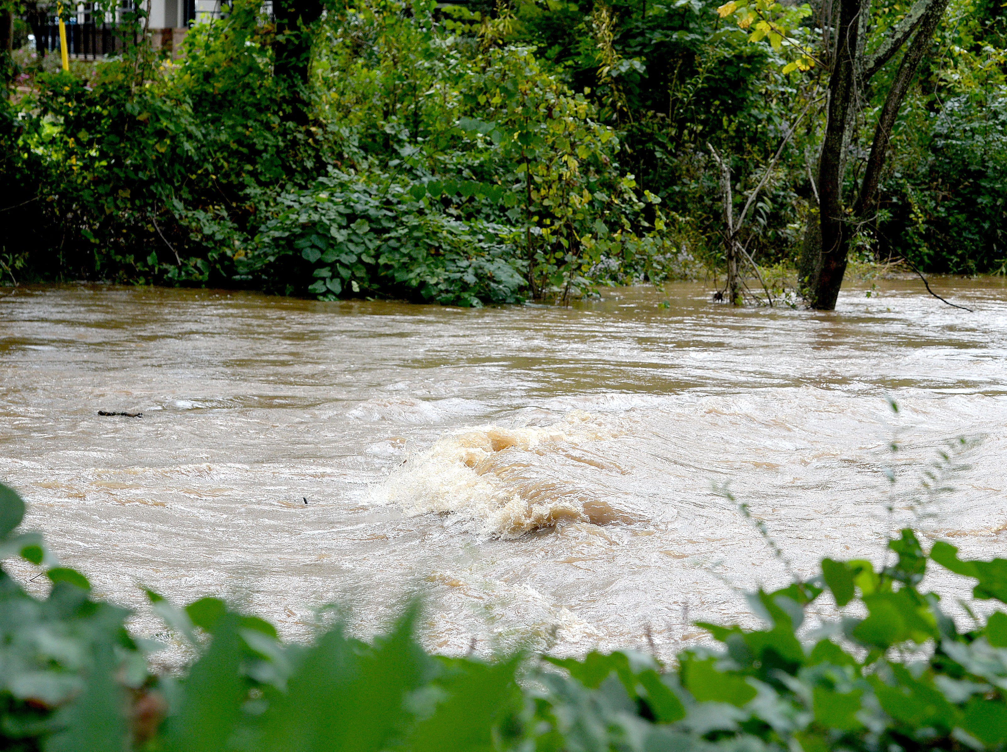 The Swannanoa River flows quickly as it swells due to rains from Hurricane Michael on Oct. 11, 2018.