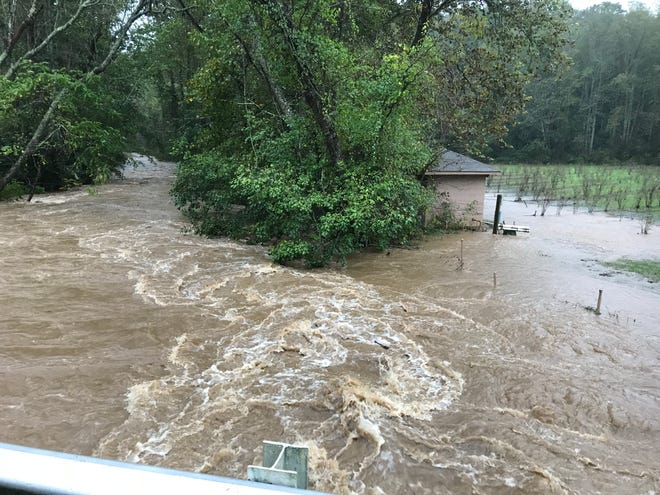 Cane Creek had overflowed its banks at the Miller Road Bridge in Fairview at 8:45 a.m. Oct. 11, 2018.