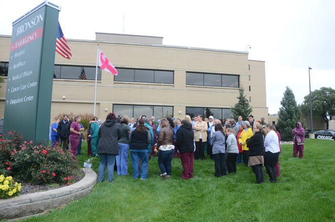 Employees of Select Specialty Hospital and Bronson Battle Creek gather Thursday, Oct. 11, 2018 for a vigil for Trish Albrecht, who was killed a week ago while crossing a street near the hospital.