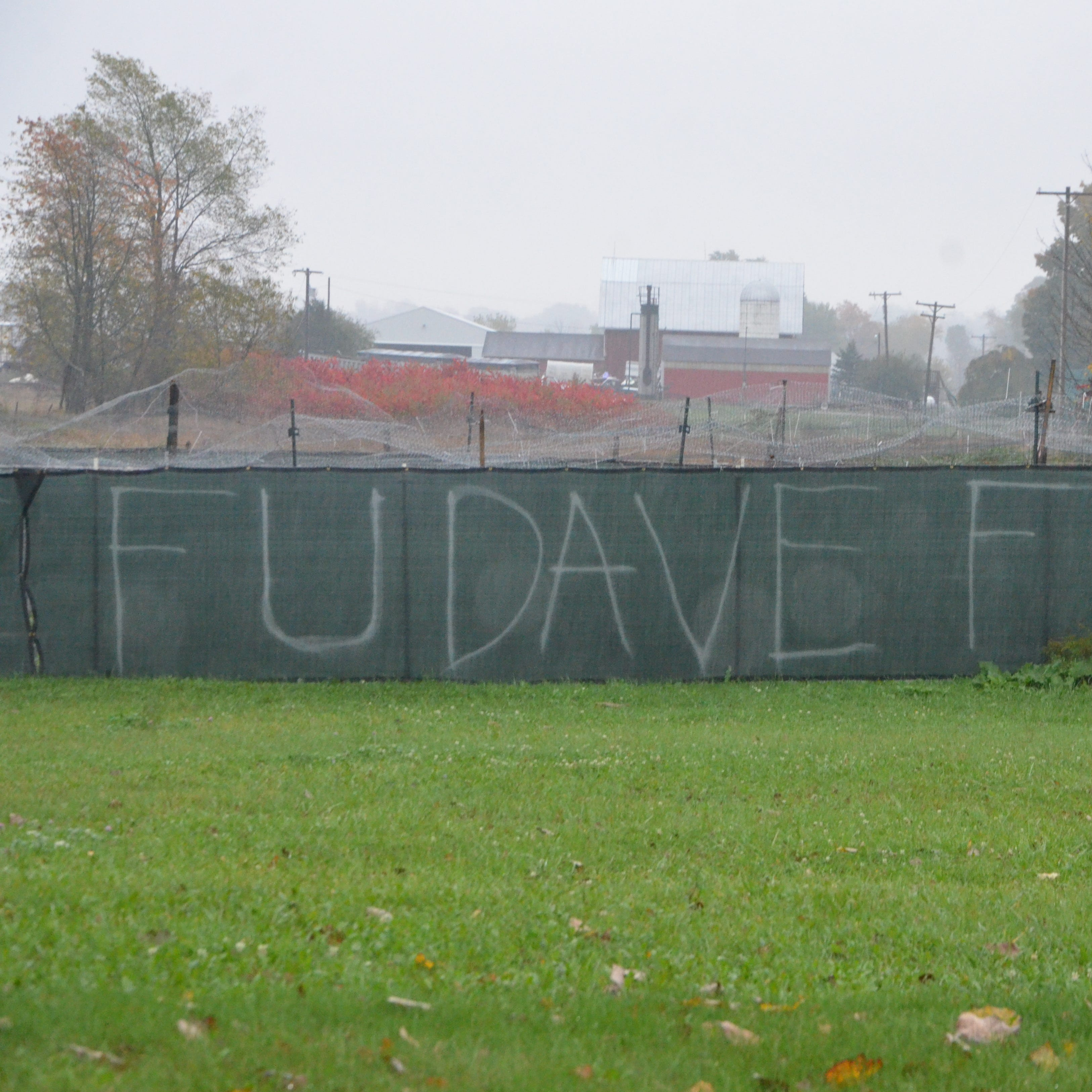 'F U Dave': Olivet neighbor dispute escalates to graffiti taunts