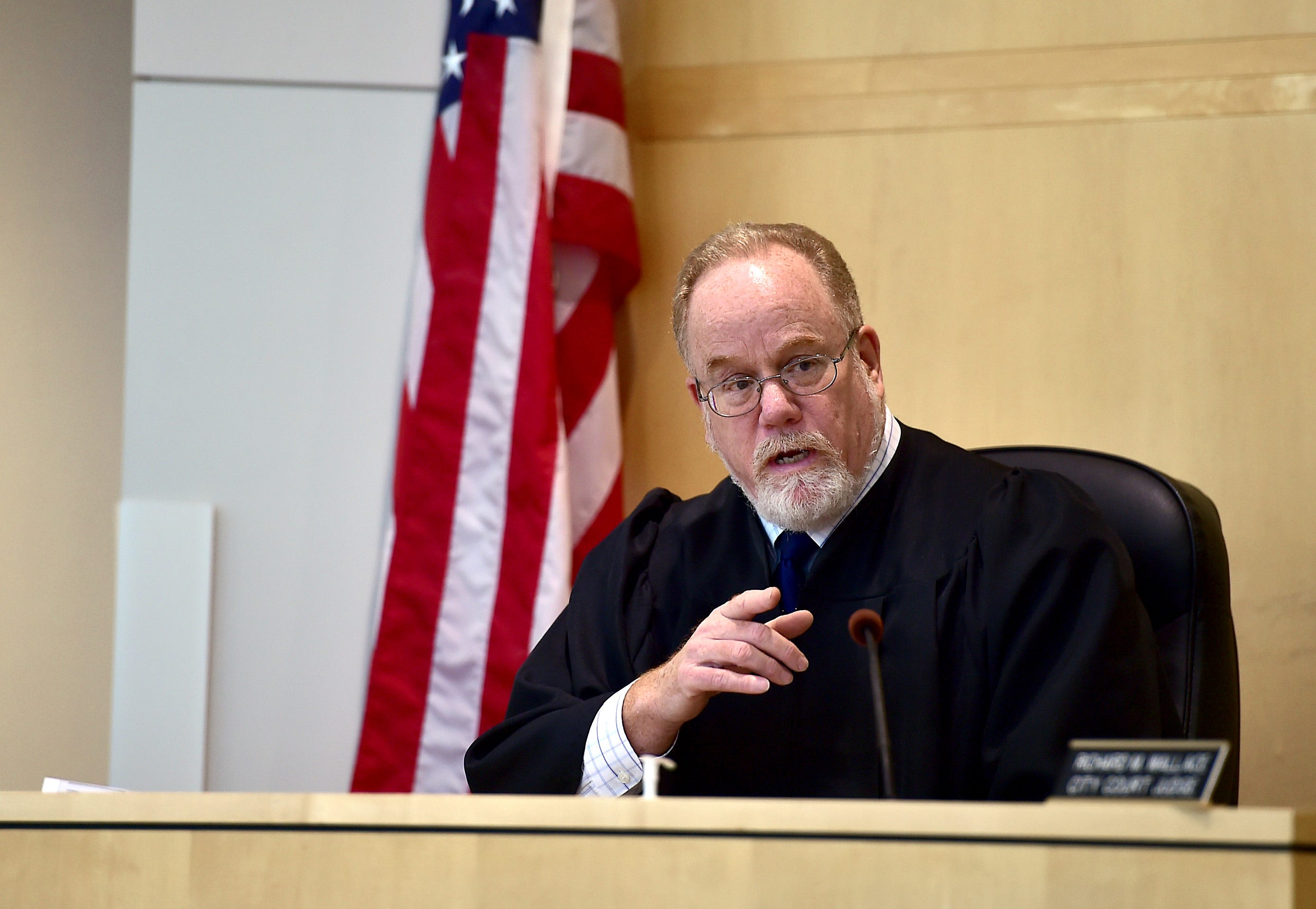 Hon. Richard M. Wallace presides over a small claims civil case in Ithaca City Court on Thursday. Small claims court serves individuals and has a monetary damage limit of $5,000.