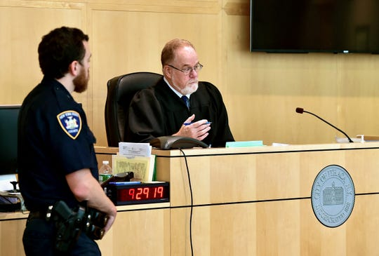 Hon. Richard M. Wallace presides over a small claims civil case in Ithaca City Court on Thursday.