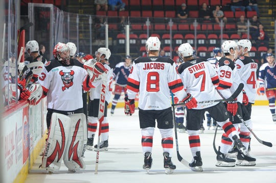 Binghamton Devils get a breather during a break in action during Wednesday's game against the Hartford Wolf Pack at Floyd L. Maines Veterans Memorial Arena.