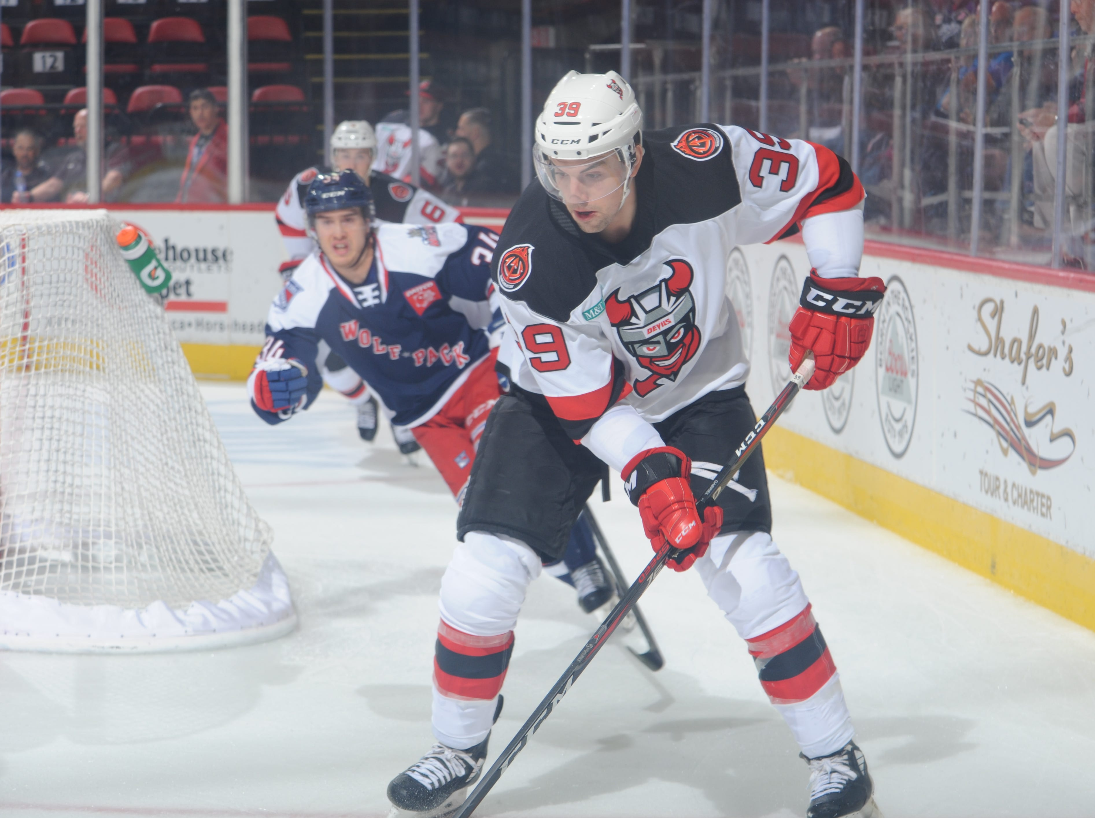 The Binghamton Devils' Kurtis Gabriel controls the puck during the first period of Wednesday's game against the Hartford Wolf Pack at Floyd L. Maines Veterans Memorial Arena.