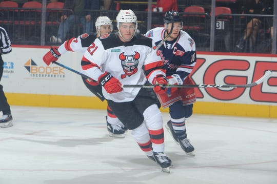 The Binghamton Devils' Kevin Rooney skates past Hartford's Cole Schneider during Wednesday's game at Floyd L. Maines Veterans Memorial Arena.