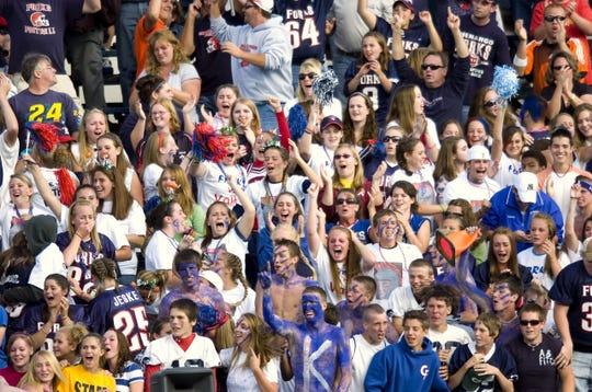 Random fans at a high school football game