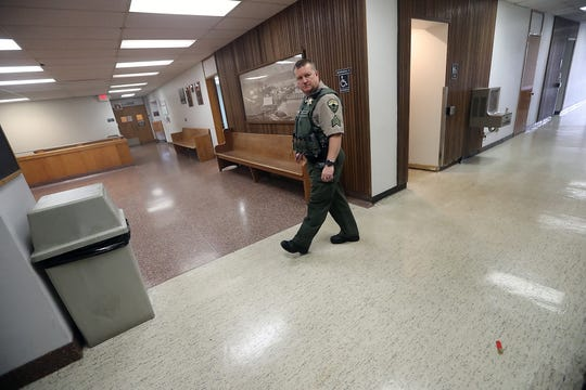 Kitsap County Sheriff's Sgt. Will Sapp checks hallways during an active-shooter drill at the Kitsap County Courthouse in Port Orchard on Thursday.