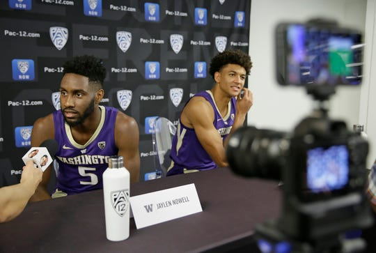 Washington's Jaylen Nowell, left, and Matisse Thybulle answer questions during Pac-12 men's basketball media day Thursday in San Francisco.