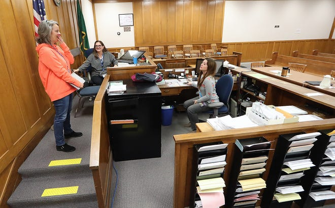 Judge Jennifer Forbes, left, gasps in surprise after hearing gunshots during an active-shooter drill Thursday at the Kitsap County Courthouse in Port Orchard. Forbes had been talking with Judge Melissa Hemstreet, center, and court clerk Cynthia Samuels.