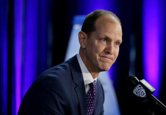 Washington coach Mike Hopkins takes questions during Pac-12 men's basketball media day Thursday in San Francisco.
