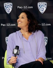 Washington head coach Jody Wynn listens to questions during NCAA college basketball Pac-12 media day in San Francisco on Wednesday.