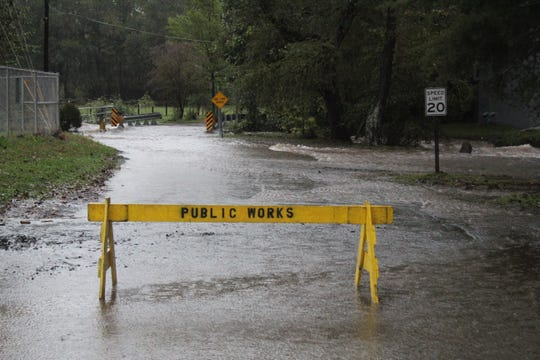 In Black Mountain, heavy rain from Tropical Storm Michael caused Flat Creek to spill over its banks on Oct. 11, forcing public works crews to close Charlotte Street.