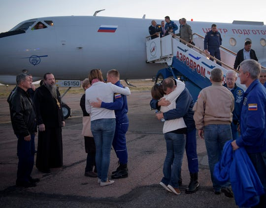 International Space Station Expedition 57 Flight Engineer Alexey Ovchinin of Roscosmos and Flight Engineer Nick Hague of NASA embrace their families after landing at the Krayniy Airport in Baikonur, Kazakhstan, Thursday, Oct. 11, 2018. Hague and Ovchinin arrived from Zhezkazgan after Russian search-and-rescue teams brought them from the Soyuz landing site. During the Soyuz TM-10 spacecraft's climb to orbit, an anomaly occurred, resulting in an abort downrange. The crew was quickly recovered and is in good condition.