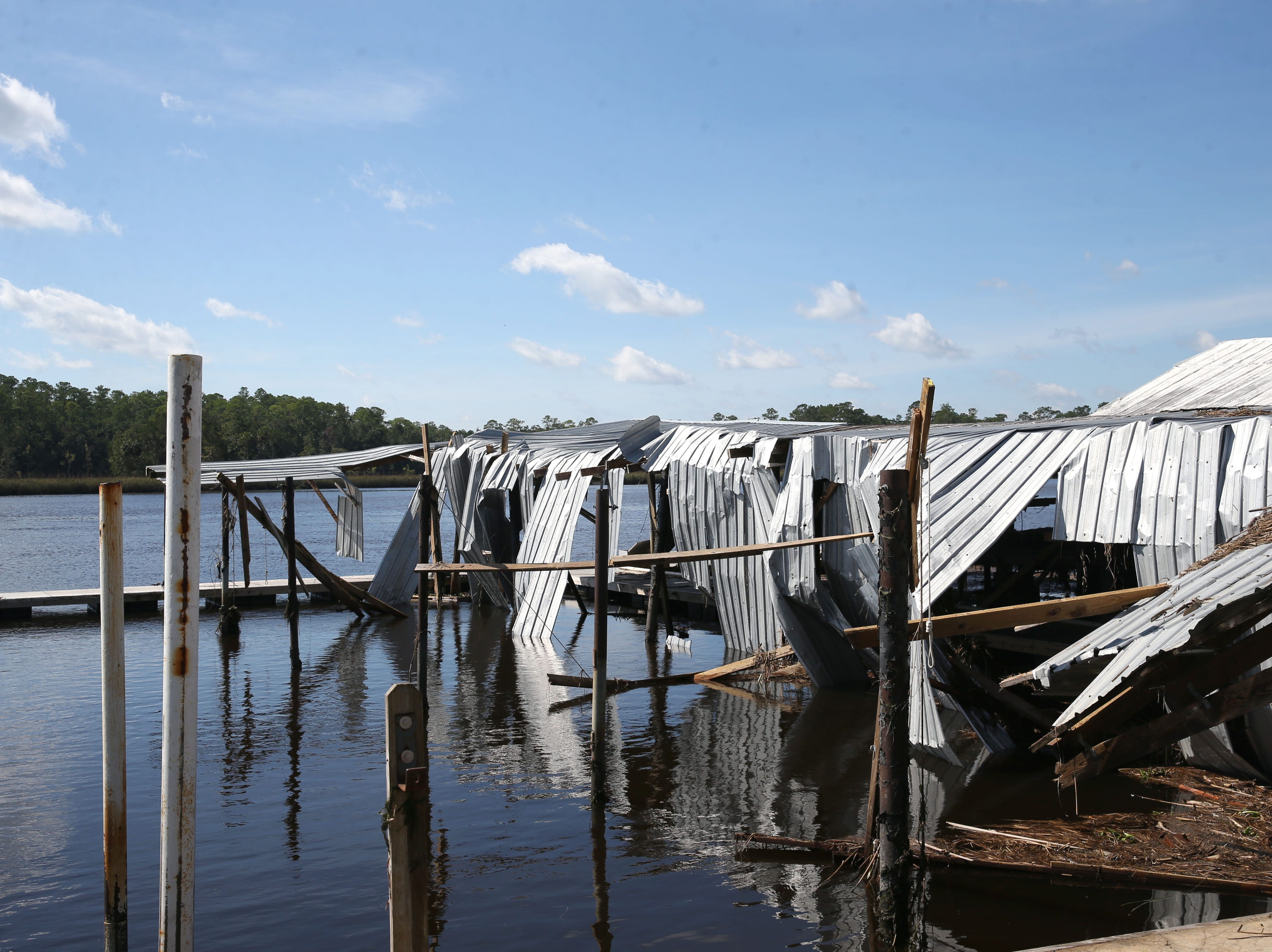 The Shell Point Fish Club in St. Marks, Fla. is left mangled by Hurricane Michael on Thursday, Oct. 11, 2018.