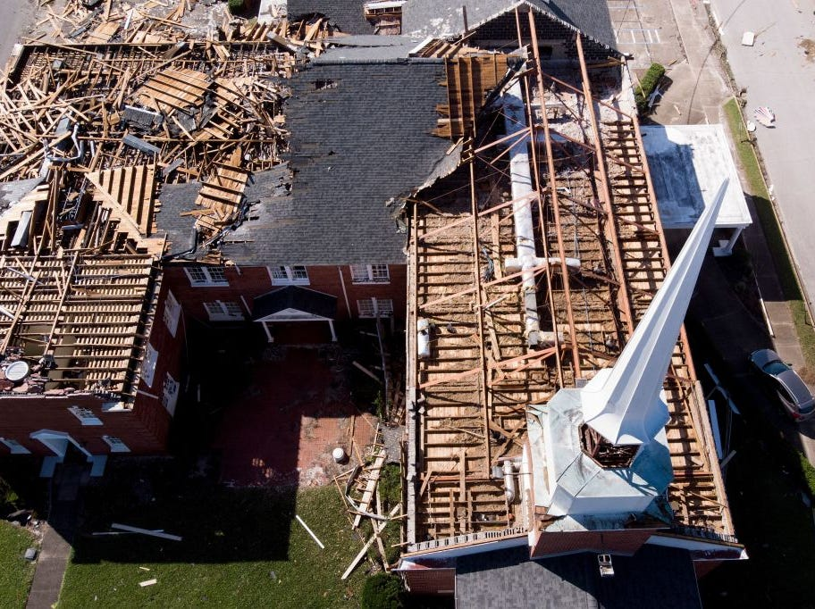 In this aerial view, a storm damaged church is seen in the aftermath of Hurricane Michael on October 11, 2018 in Panama City, Florida. - Residents of the Florida Panhandle woke to scenes of devastation Thursday after Michael tore a path through the coastal region as a powerful hurricane that killed at least two people. (Photo by Brendan Smialowski / AFP)        (Photo credit should read BRENDAN SMIALOWSKI/AFP/Getty Images)