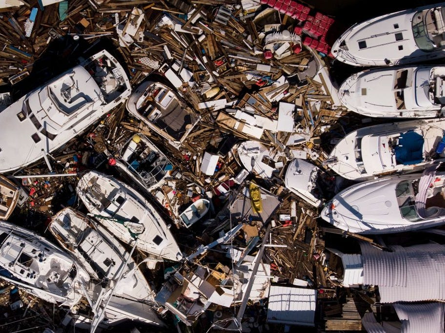 In this aerial view, storm damaged boats are seen in the aftermath of Hurricane Michael on October 11, 2018 in Panama City, Florida. - Residents of the Florida Panhandle woke to scenes of devastation Thursday after Michael tore a path through the coastal region as a powerful hurricane that killed at least two people. (Photo by Brendan Smialowski / AFP)        (Photo credit should read BRENDAN SMIALOWSKI/AFP/Getty Images)
