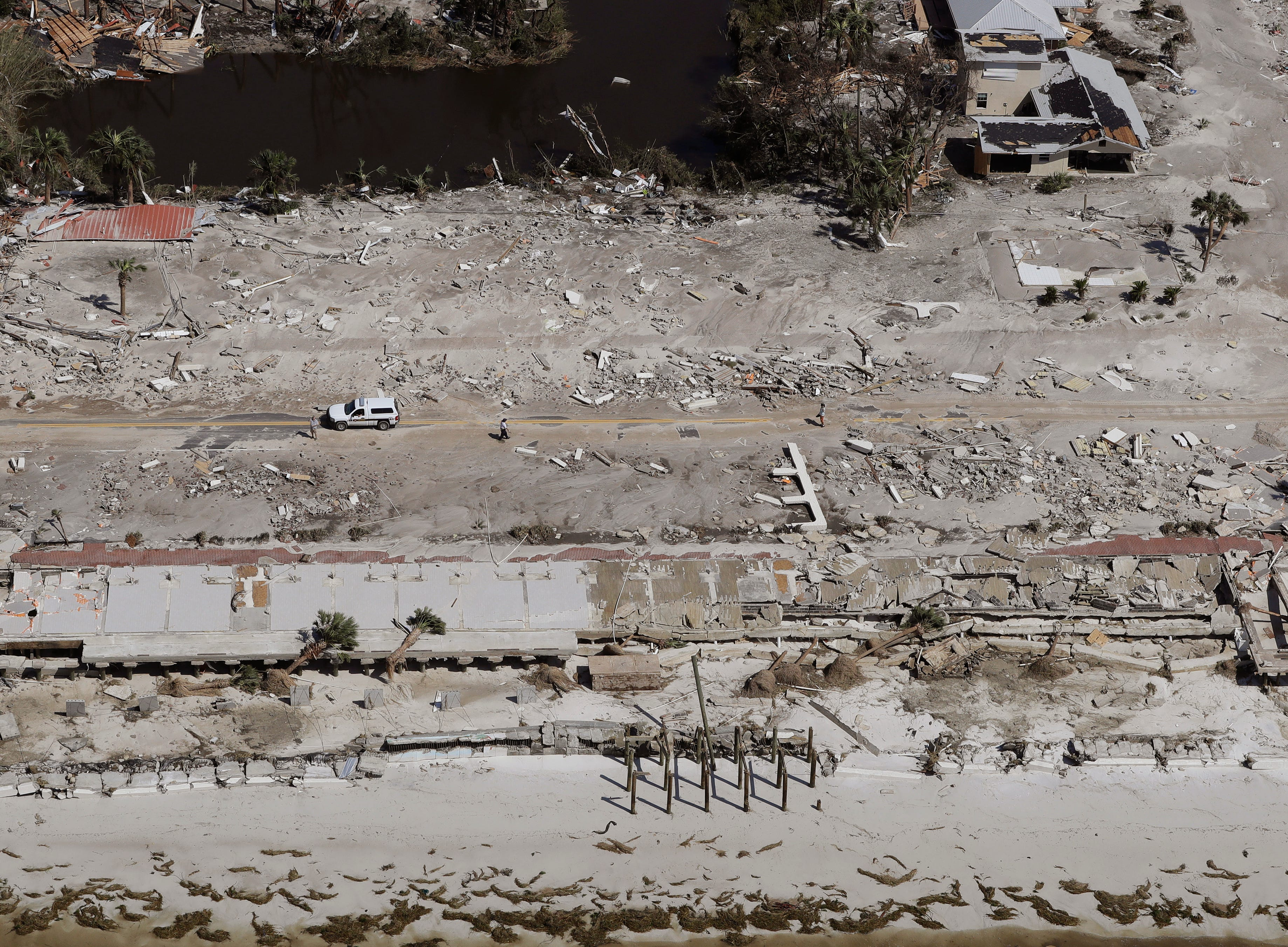 Homes washed away by Hurricane Michael are shown in this aerial photo Thursday, Oct. 11, 2018, in Mexico Beach, Fla.  Michael made landfall Wednesday as a Category 4 hurricane with 155 mph (250 kph) winds and a storm surge of 9 feet (2.7 meters). (AP Photo/Chris O'Meara)
