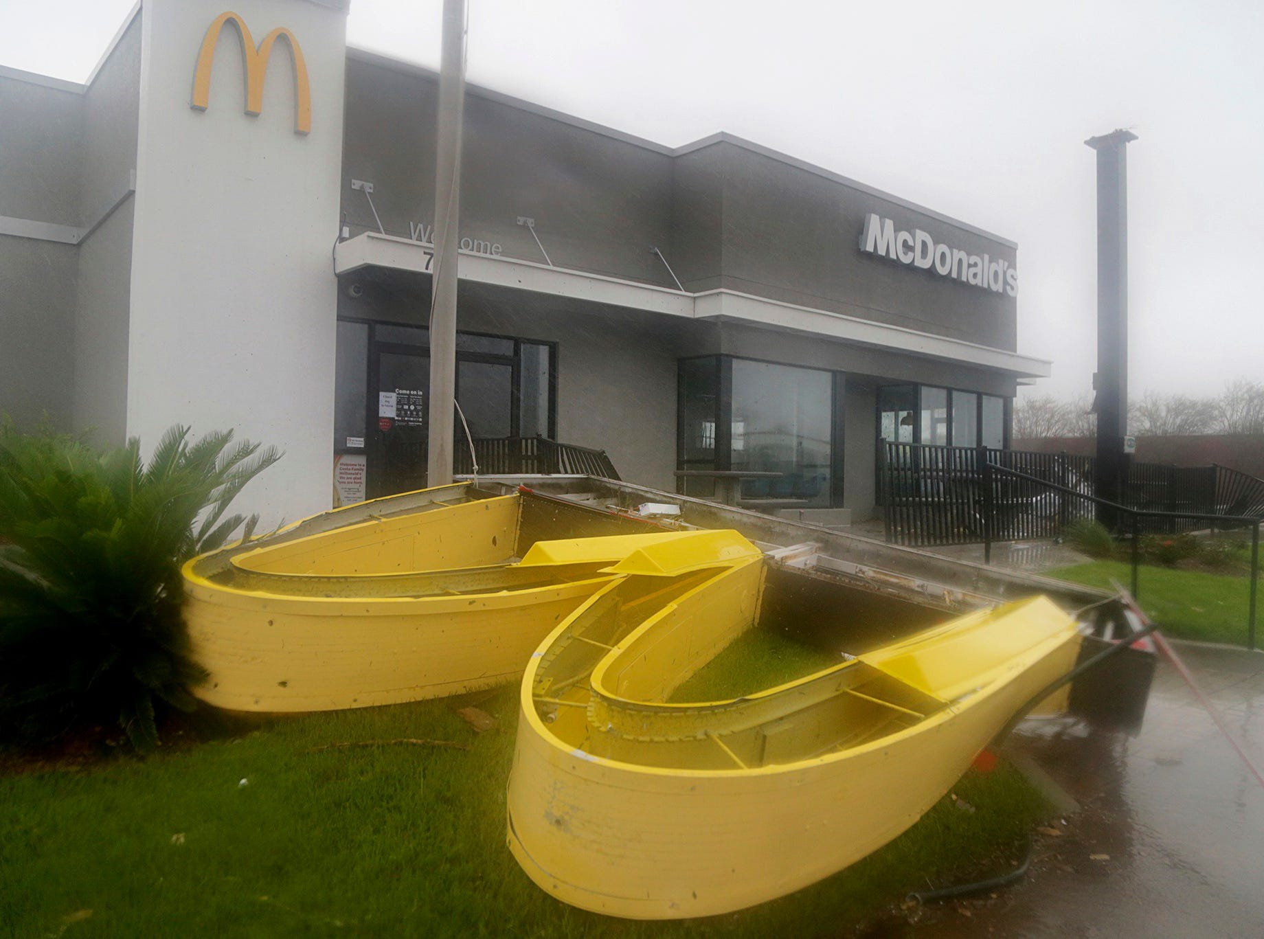 This photo shows a McDonald's restaurant damaged after Hurricane Michael went through the area in Panama City, Fla., Wednesday, Oct. 10, 2018. Supercharged by abnormally warm waters in the Gulf of Mexico, Hurricane Michael slammed into the Florida Panhandle with terrifying winds of 155 mph Wednesday, splintering homes and submerging neighborhoods before continuing its march inland. (Pedro Portal/Miami Herald via AP)