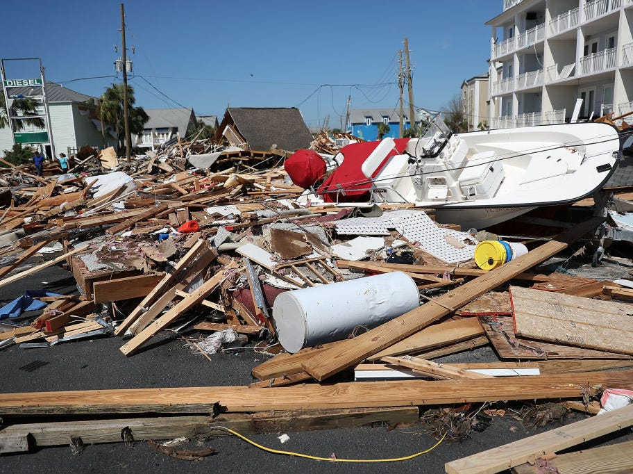MEXICO BEACH, FL - OCTOBER 11:  Debris is seen piled in the street after Hurricane Michael passed through the area on October 11, 2018 in Mexico Beach, Florida.  The hurricane hit the panhandle area with category 4 winds causing major damage.  (Photo by Joe Raedle/Getty Images)