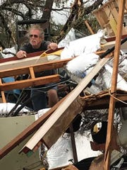 "R.J. Juncker of Panama City, Florida, stands in what remains of a 5,000-square-foot building he owned for 32 years. Despite the destruction around him, Juncker said he never was scared. ""I'm saved. I know where I'm going,"" he said."