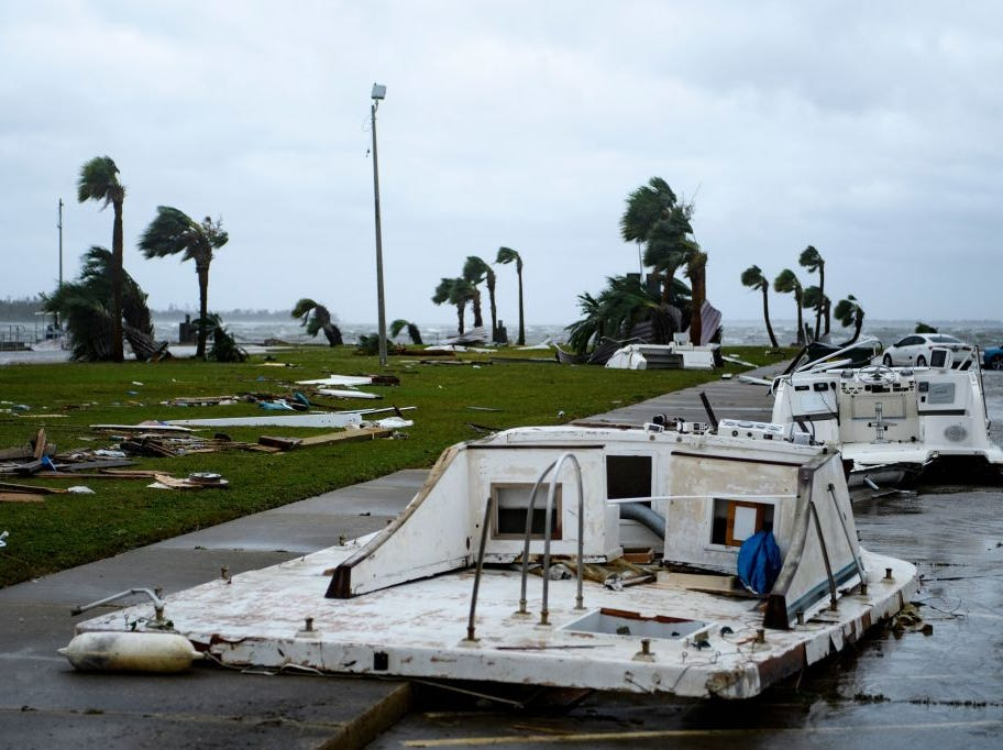"Damaged boats and cars are seen in a marina after Hurricane Michael October 10, 2018 in Panama City, Florida. - Michael slammed into the Florida coast on October 10 as the most powerful storm to hit the southern US state in more than a century as officials warned it could wreak ""unimaginable devastation."" Michael made landfall as a Category 4 storm near Mexico Beach, a town about 20 miles (32kms) southeast of Panama City, around 1:00 pm Eastern time (1700 GMT), the National Hurricane Center said. (Photo by Brendan Smialowski / AFP)        (Photo credit should read BRENDAN SMIALOWSKI/AFP/Getty Images)"