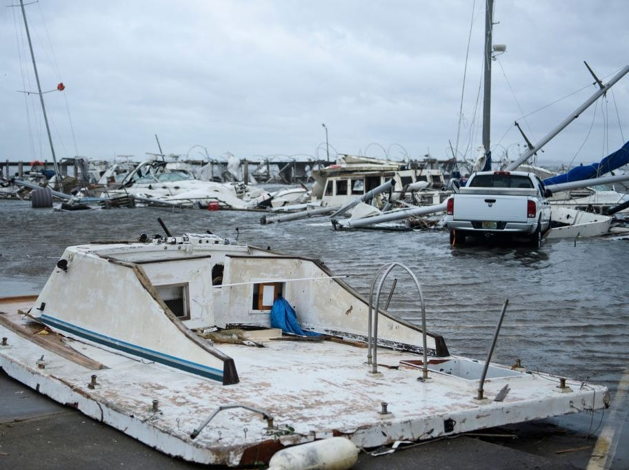 "Damaged boats and a truck are seen in a marina after Hurricane Michael October 10, 2018 in Panama City, Florida. - Michael slammed into the Florida coast on October 10 as the most powerful storm to hit the southern US state in more than a century as officials warned it could wreak ""unimaginable devastation."" Michael made landfall as a Category 4 storm near Mexico Beach, a town about 20 miles (32kms) southeast of Panama City, around 1:00 pm Eastern time (1700 GMT), the National Hurricane Center said. (Photo by Brendan Smialowski / AFP)        (Photo credit should read BRENDAN SMIALOWSKI/AFP/Getty Images)"