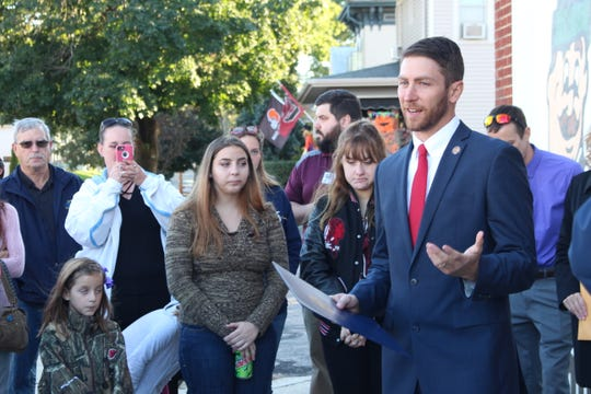State Rep. Riordan McClain (R-Upper Sandusky) speaks during a dedication ceremony for the city's new Community Unity mural Thursday, Oct. 11, 2018. Art teachers and students from Bucyrus, Colonel Crawford and Wynford designed and painted the mural.