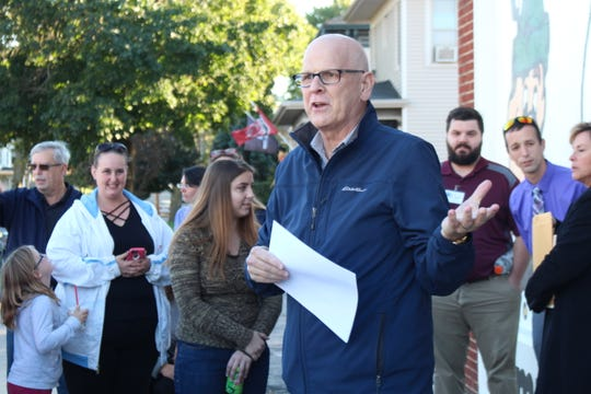 Bucyrus Mayor Jeff Reser speaks during a dedication ceremony for the city's new Community Unity mural Thursday, Oct. 11, 2018. Art teachers and students from Bucyrus, Colonel Crawford and Wynford designed and painted the mural.