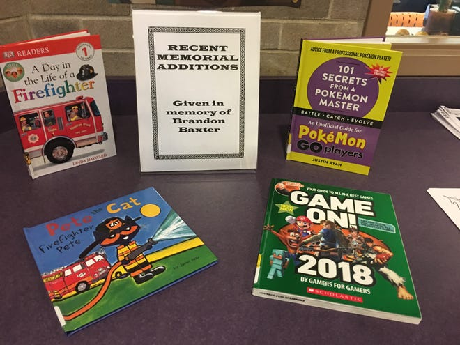 The Bucyrus Public Library recently received four books that were donated in memory of Brandon Baxter, through the library's honor book program.