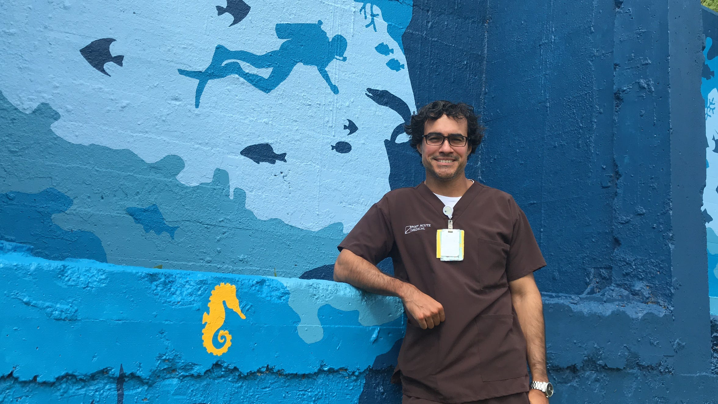 Cristobal Lopez, a physical therapy assistant at Post Acute Medical Rehabilitation Hospital, created a 100-square-foot mural for patients to look at across the street of the hospital in downtown Corpus Christi.