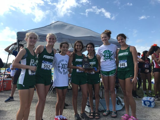 The Rockport-Fulton girls cross-country team poses for photos after winning the District 31-4A cross-country title at Live Oak Park in Ingleside on Thursday, Oct. 11, 2018.